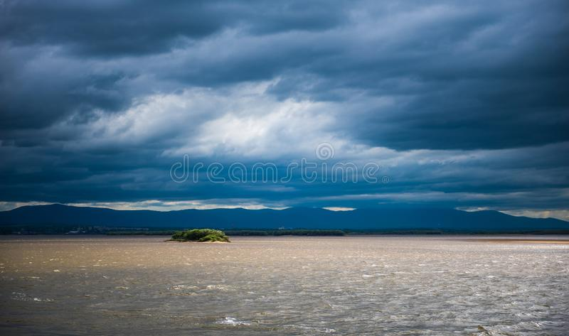 The island is among the huge river. royalty free stock image
