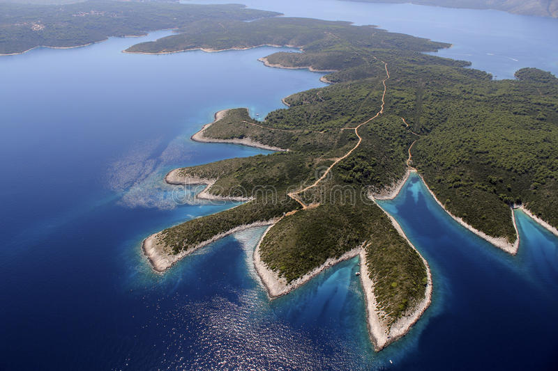 Island Hvar from air. Shot from air, north-west side of island Hvar in Adriatic Sea, the longest and the sunniest Croatian island and one of the most beautiful stock photo