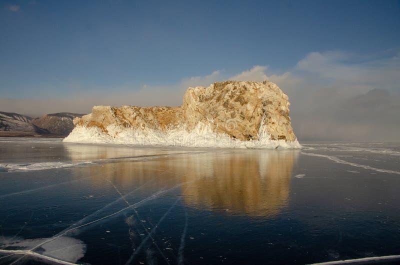 Island icebound Lake Baikal. Island surrounded by ice of Lake Baikal royalty free stock photo