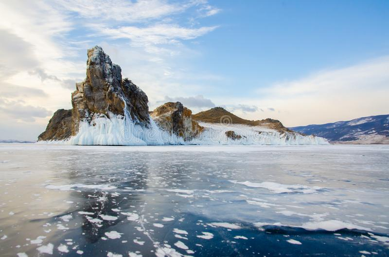 Island icebound Lake Baikal. Island surrounded by ice of Lake Baikal royalty free stock photos