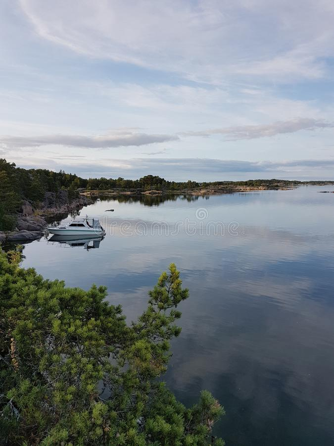 An island and its cape of rock in Finland royalty free stock images