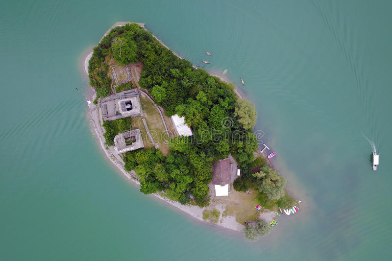 Island on Lake de Gruyere, Switzerland. Aerial view of Ogoz Island & x28;l& x27;Ile d& x27;Ogoz& x29; on Lake de Gruyere in Switzerland. The island, accessible stock photos
