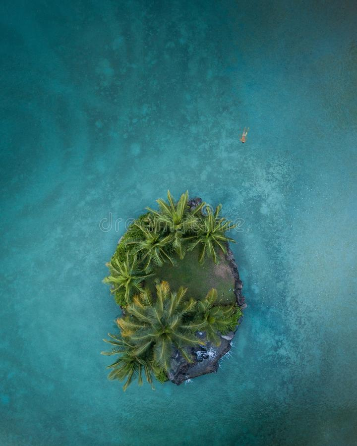 Island life. Secluded tropical island in Hawaii royalty free stock photos
