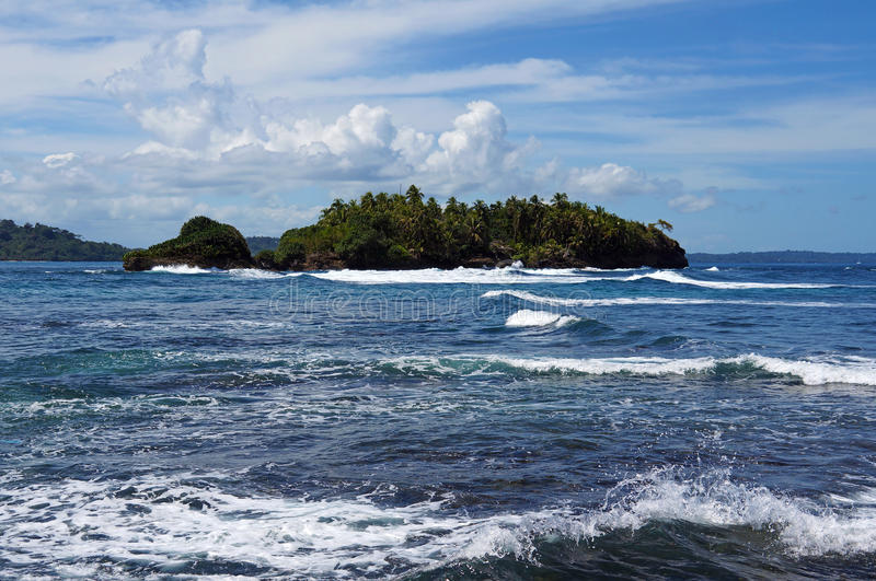 Download Island With Lush Vegetation And Rough Sea Stock Photo - Image: 31400152