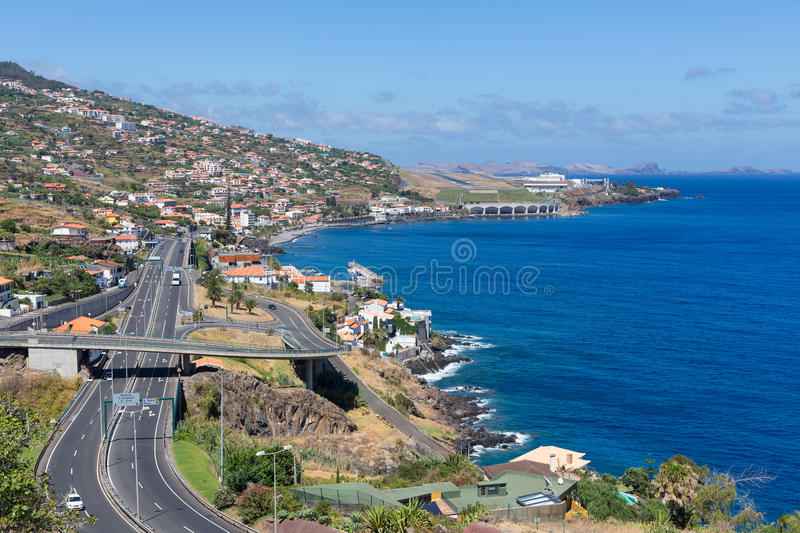 Island Madeira with Highway along Santa Cruz and a view at the airport. Coastline Madeira with Highway along Santa Cruz and a view at the airport stock image