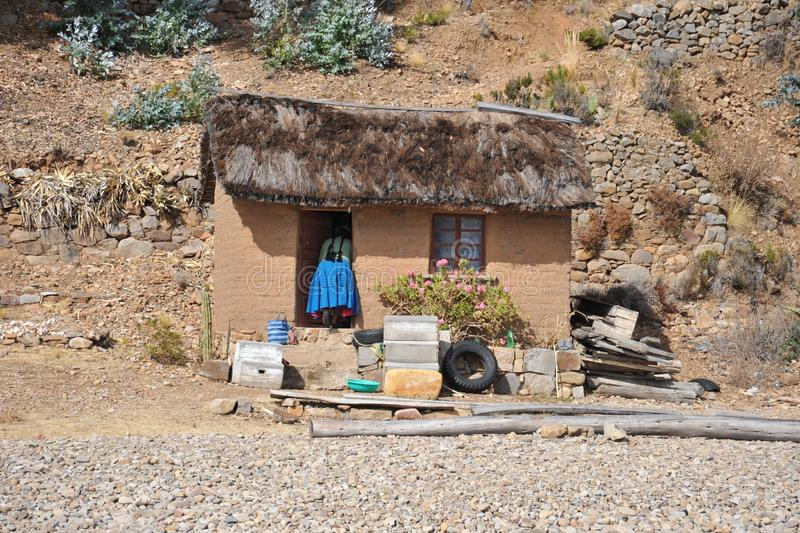 Island of the moon is located on lake Titicaca. The Incas live here in seclusion. Young women weave garments of Alpaca wool royalty free stock photo