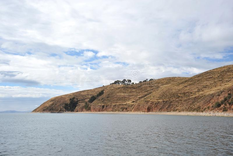 Island of the moon is located on lake Titicaca. At the time of the Incas lived here in seclusion young women, which wove the garments of wool Alpaca royalty free stock image