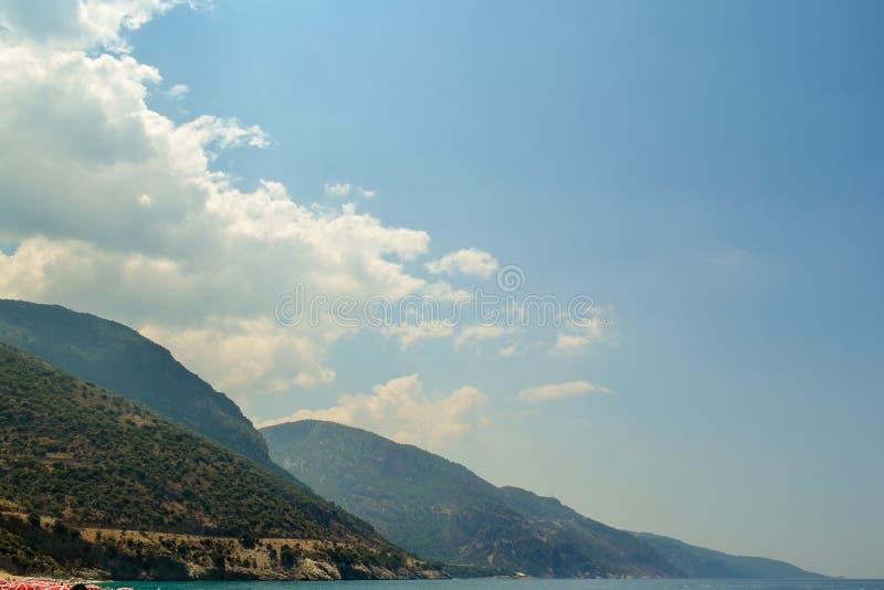 The island is mountainous island in the beautiful blue sky.  stock photo