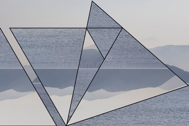 Island with mountains in the fog, surrounded by the sea. Trendy minimalist Polyscape effect with triangles stock image