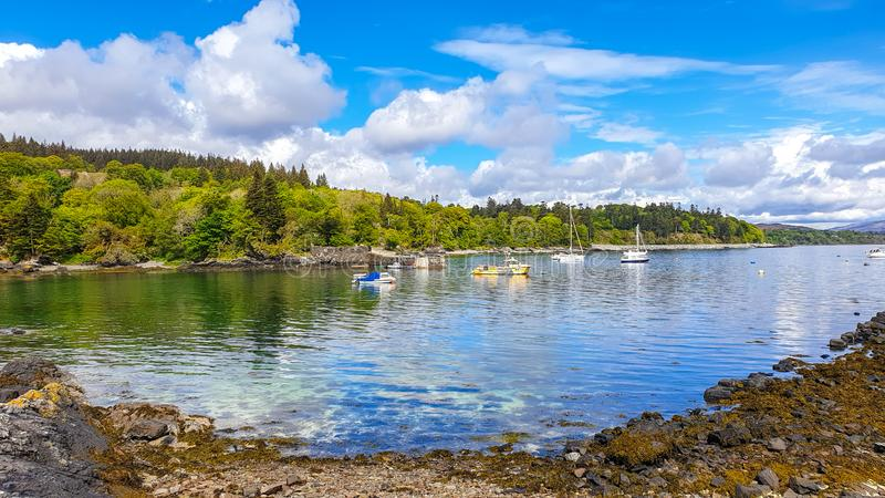Island of Mull in Scotland. Island mull scotland scenic scenery beautiful water sea loch vacation holiday trip ferry clouds sky sun historic tobermory coats royalty free stock photos