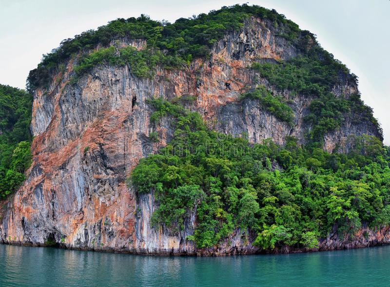 Island, Ocean views near Phuket Thailand with Blues, Turquoise and Greens oceans, mountains, boats, caves, trees resort island of royalty free stock photography