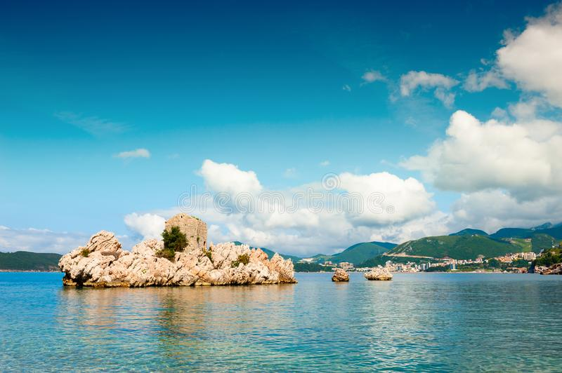 Island with old castle on the beach in Montenegro. Island with old castle on the beach in Przno near Budva, Montenegro. Adriatic sea. Famous travel destination royalty free stock photography