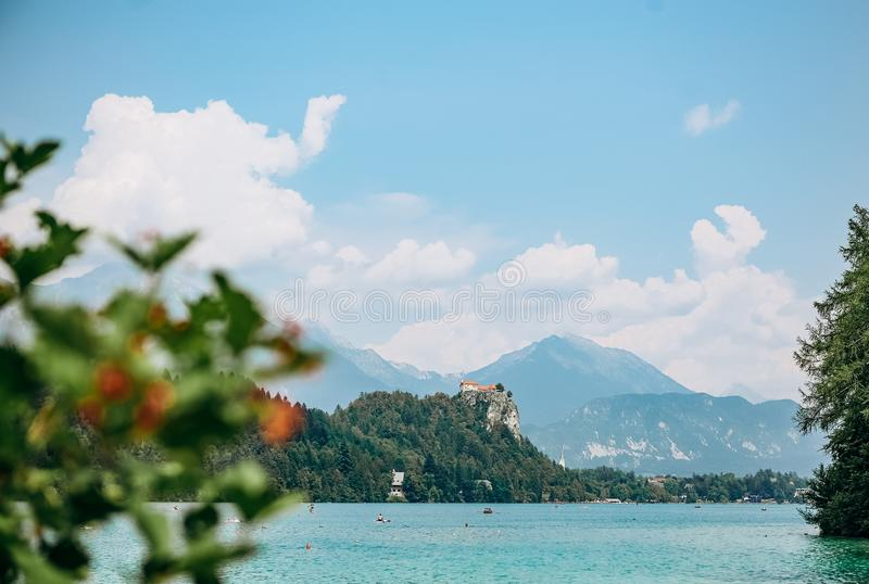 Island prayer cathedral bled lake mountains background stock photo