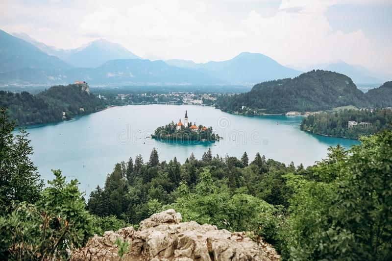 island prayer cathedral bled lake mountains background royalty free stock photography