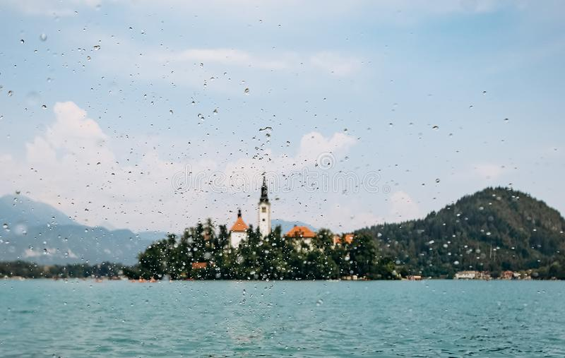 Island prayer cathedral bled lake mountains background royalty free stock photos