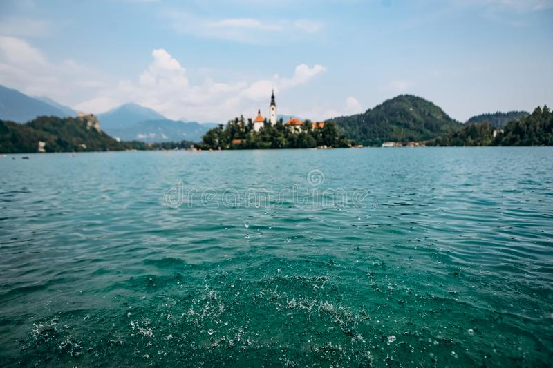 Island prayer cathedral bled lake mountains background royalty free stock image
