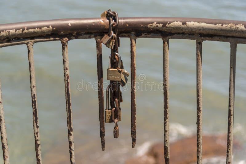 Rusting guard rail padlock and chain Corredor Artesanal De Casco Antiguo. Old Town Panama. Panama City, the capital of Panama, is a modern city framed by the stock photo