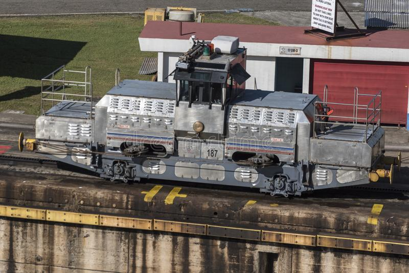 Mule Locomotive at Miraflores Locks Panama Canal Panam. A. The Panama Canal is an artificial 82 km waterway in Panama that connects the Atlantic Ocean with the stock image