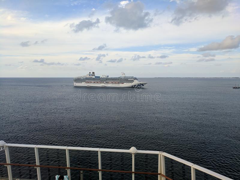 Island Princess cruise ship as seen from the deck of another ship stock image