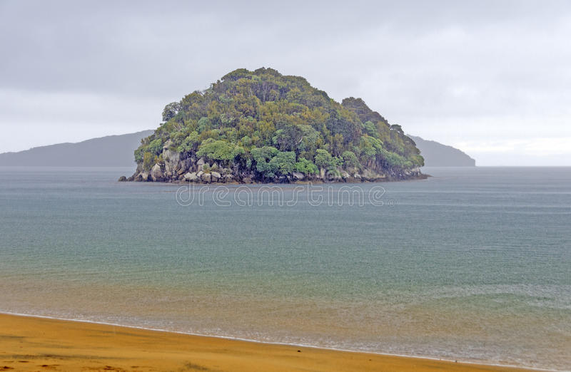 Island in a Rainstorm on the Ocean stock photo