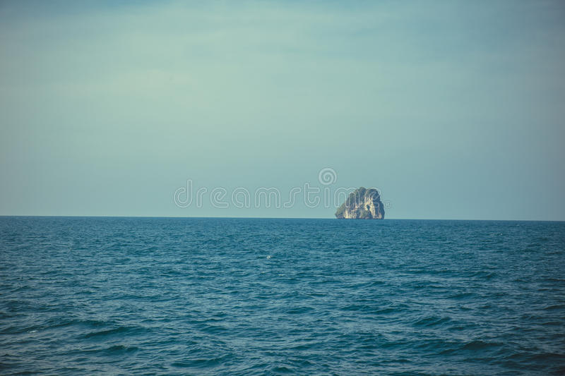 Island rock stand-alone over sea and blue sky wide shot background. Thailand stock photo