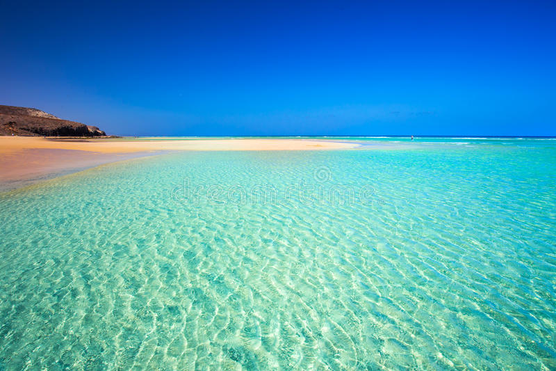 Island with sandy beach, green lagoon and clear water, Mal Nobre, Fuerteventura, Canary island, Spain. royalty free stock photography