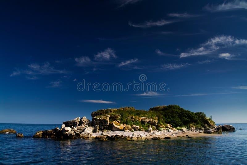 Island in sea royalty free stock photos