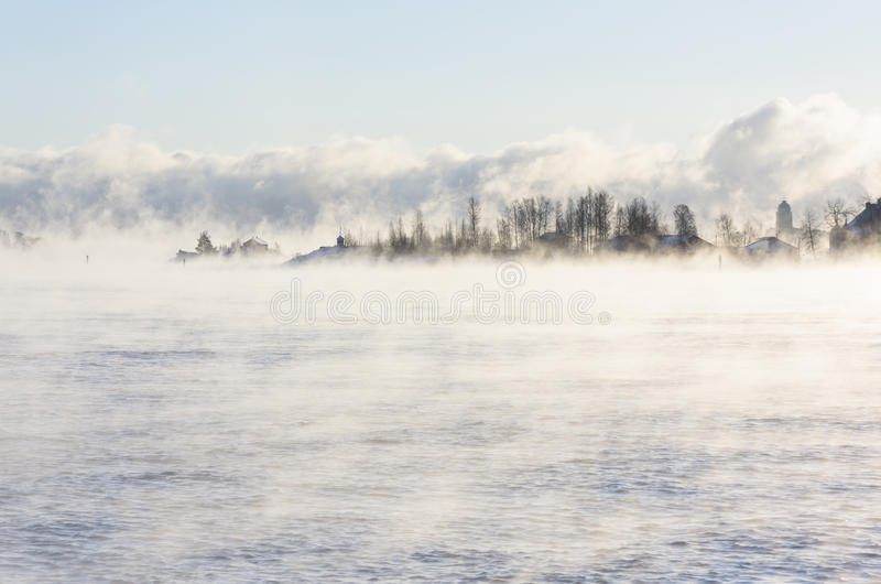 Download Island in a steamy water stock photo. Image of mist, foggy - 83704248