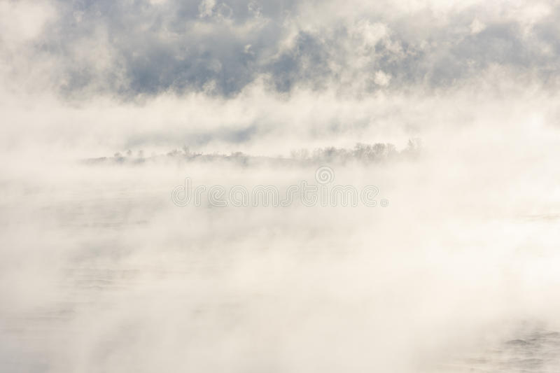 Download Island in a steamy water stock image. Image of land, cold - 83704375
