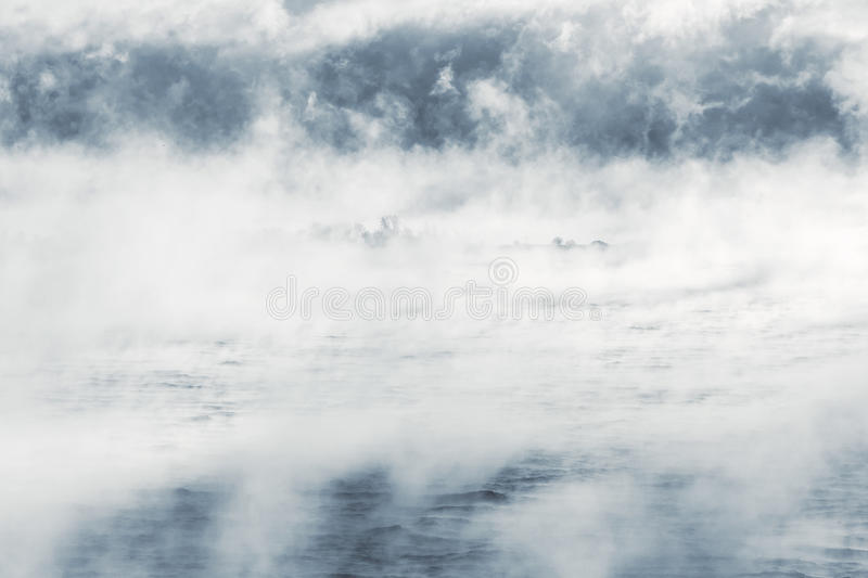 Download Island in a steamy water stock image. Image of misty - 83704885
