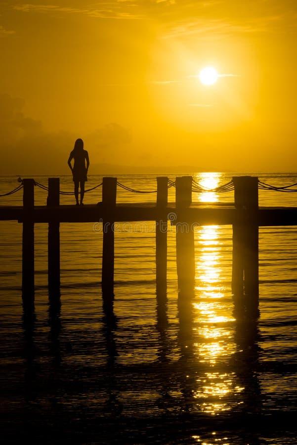 Island sunset Girl on Pier royalty free stock photos