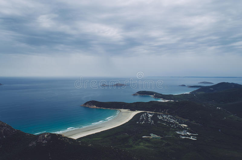 Island Surrounded By Blue Body Of Water Under Grey Clouds During Daytime Free Public Domain Cc0 Image