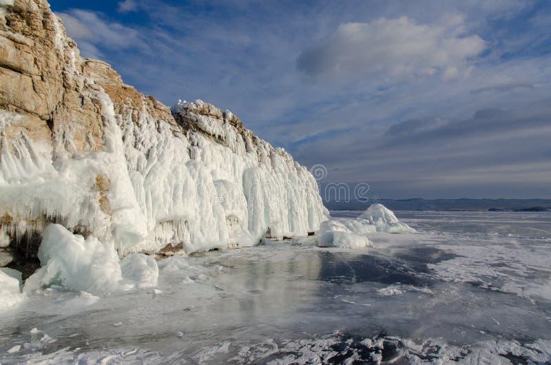 Island icebound Lake Baikal. Island surrounded by ice of Lake Baikal royalty free stock image