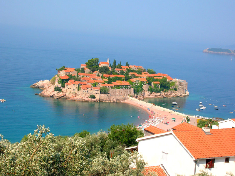 Island Sveti Stefan. In blue sea royalty free stock photos