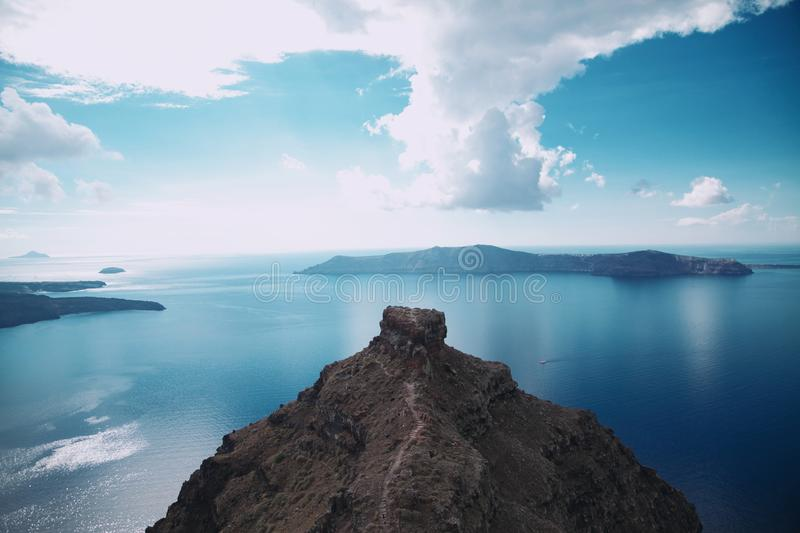 Island Under White Clouds royalty free stock image