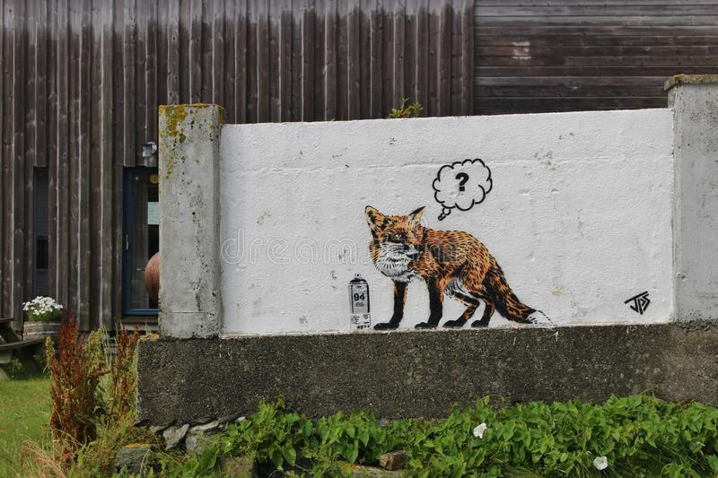 On the island Utsira, Norway. A street Artist painted a fox on a wall. Utsira is a small island in the North Sea, about 18 kilometers West of Haugesund royalty free stock images