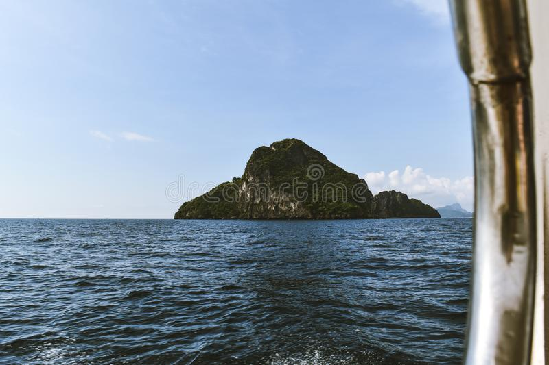 Island visible from a boat royalty free stock images