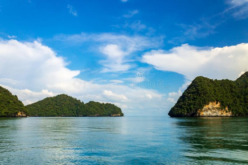 Islands in the area of Tanjung Rhu or Tanjong Rhu beach on Langkawi island, Andaman Sea, state of Kedah, Malaysia. Islands with limestone cliff and forest in the royalty free stock photo