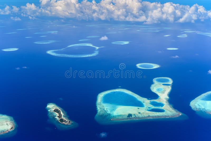 Islands in Baa Atoll, Indian Ocean. Aerial view of islands in Baa Atoll, Maldives, Indian Ocean on sunny day stock photos