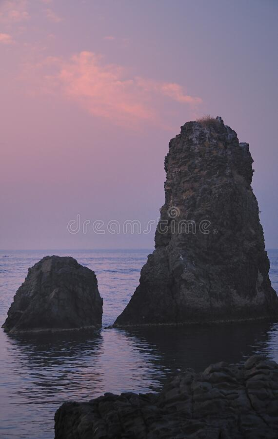 Islands of the Cyclops at Dawn Sicily Italy - Creative Commons by gnuckx stock image