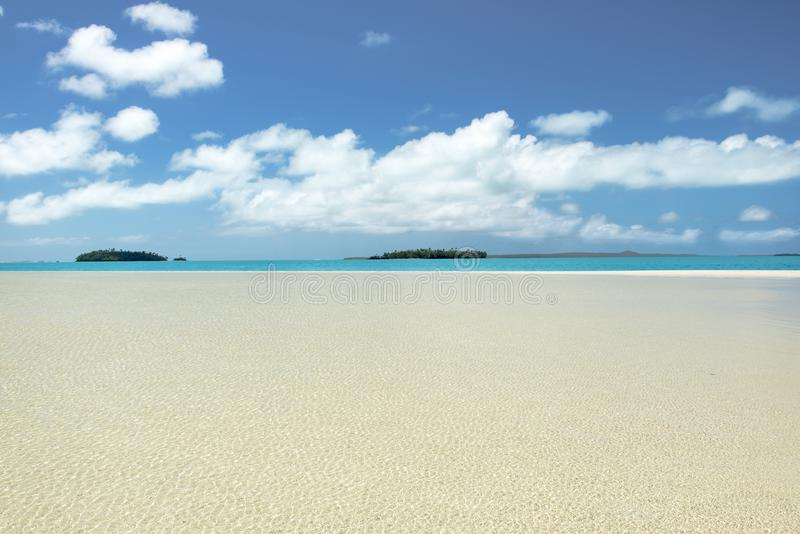 Absolute clear water, deep blue sky, white sand, perfect islands in Pacific Ocean royalty free stock photography
