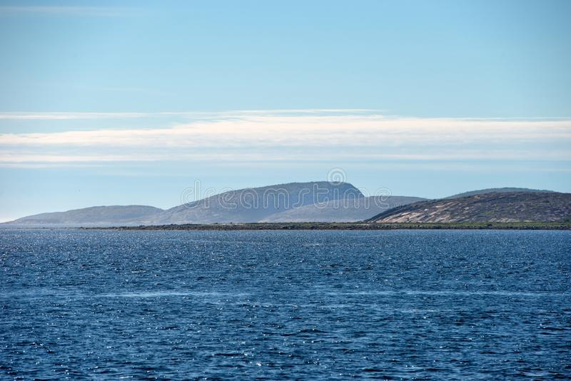 Several small islands. Islands of the Kuzova Archipelago in the White Sea on a summer day stock photos