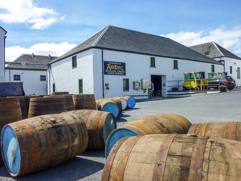Islay, Scotland - Sseptember 11 2015: The sun shines on Ardbeg distillery warehouse. ISLAY, SCOTLAND - SEPTEMBER 11 2015: The sun shines on Ardbeg distillery royalty free stock image