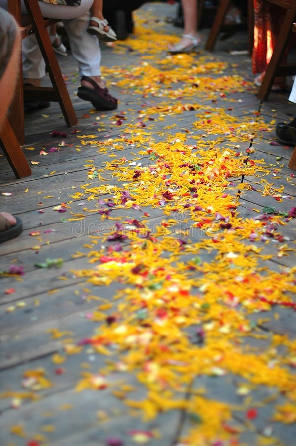 The Isle. Flower petals cover a wedding ceremony isle stock photos