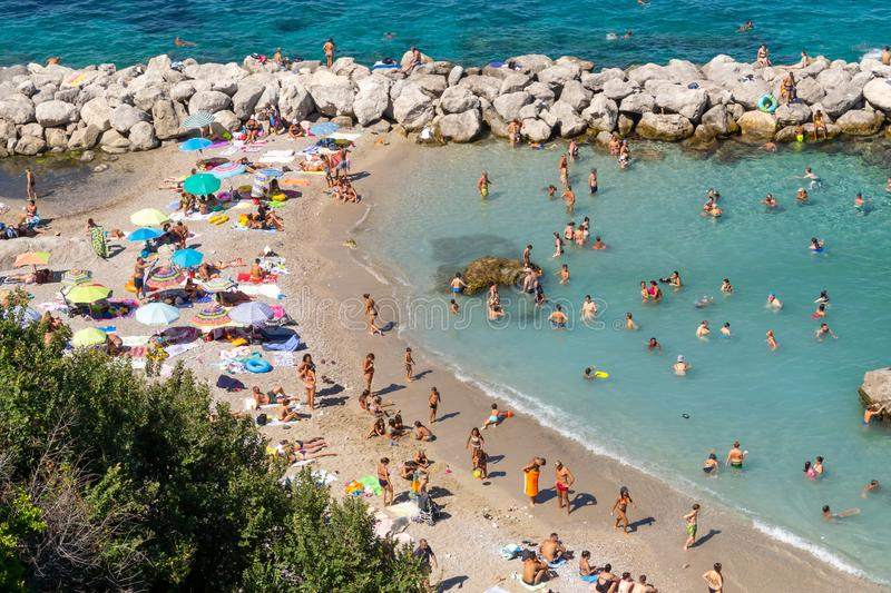 Isle of Capri, Italy - August, 2019: aerial view of bathers in Marina Grande Beach. Bay, coast, people, sea, summer, tourism, travel, vacation, amalfi stock photo