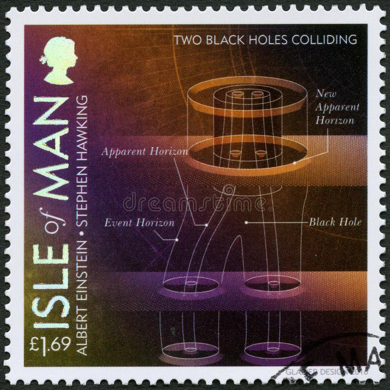 ISLE OF MAN - 2016: shows Two Black Holes Colliding, 100 Years of General Relativity. ISLE OF MAN - CIRCA 2016: A stamp printed in Isle of Man shows Two Black stock photos
