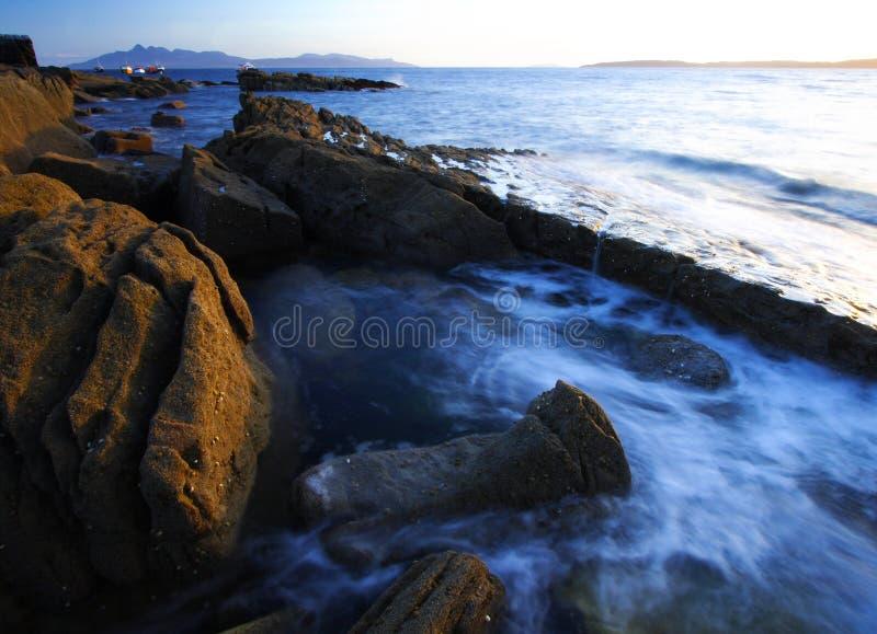Isle of skye. Elgol, Isle of skye at sunset. Last lights on the rocks at port Elgol. Long exposure stock photography