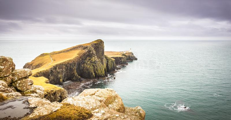 Isle of Skye landscape - Neist Point lighthouse, rocky cliffs, Atlantic Ocean stock photo