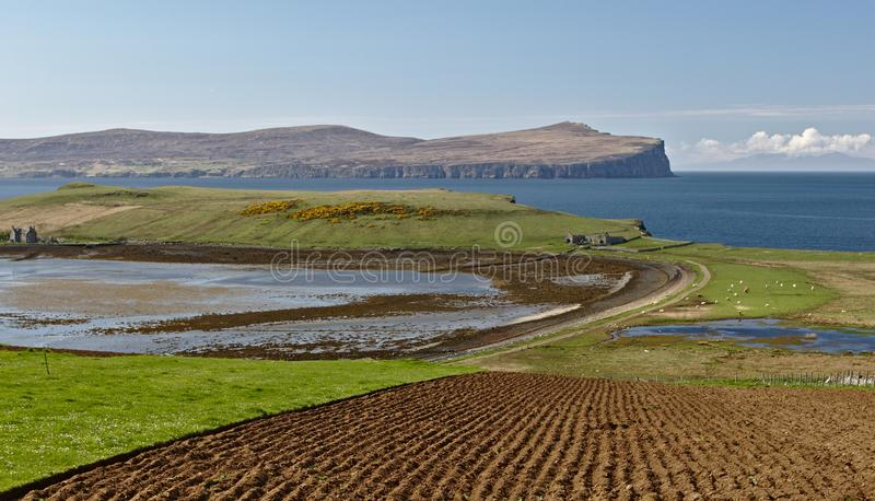Isle of Skye, Scotland - View across Ardmore point towards distant Dunvegan Head with towering sea cliffs and the deep blue ocean stock photos