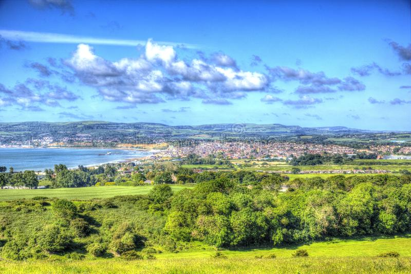 Isle of Wight coast view towards Shanklin and Sandown from Culver Down in vivid and bright HDR. Isle of Wight coast view towards Shanklin and Sandown from Culver stock photography